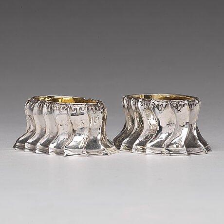 A pair of swedish 18th century parcel-gilt silver salt cellars, mark of olof löfvander, luleå 1783.