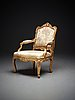 A swedish rococo armchair by olof höglander (master in stockholm 1745-65).