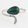 Isaac cohen silver bangle with green stone.