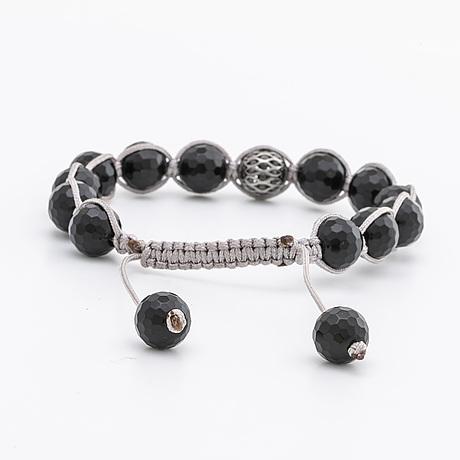 Bracelet facetted onyx beads approx 10 mm, 1 bead 18k whitegold w black diamonds, grey silk chord