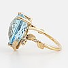 Pear shaped briolette cut blue topaz and brilliant cut diamond cocktail ring