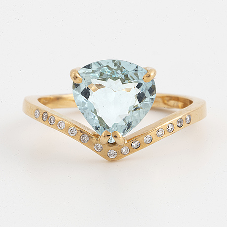 Pear shaped aquamarine and brilliant cut diamond ring