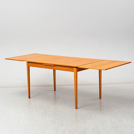 A late 20th century teak veneered table
