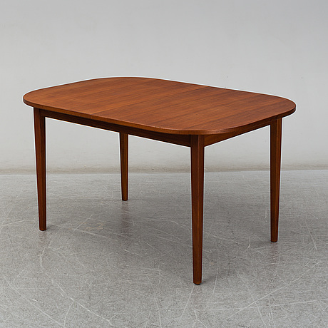 A late 20th century teak veneered table