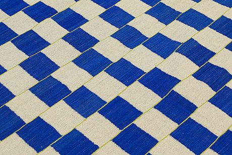 A carpet, flat weave, around 194 x 162 cm.