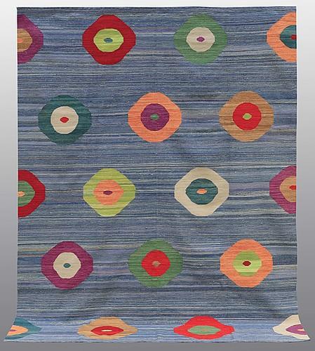 A rug, flat weave, around 277 x 214 cm