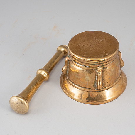 A 17th century bronze mortar and pestle.