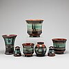 Maggi wibom, a set of 7 faience vases, flower pots, candle holders, bo fajans, sweden, 1920-30s.