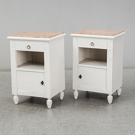A pair of stone top bedside tables, early 20th century