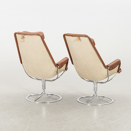 A pair of 'jetson' revolving easy chairs by bruno mathsson