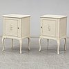 A pair of painted bedside tables, mid 20th century