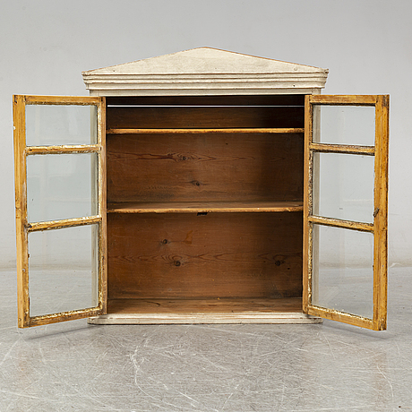 A mid 19th century wall cabinet
