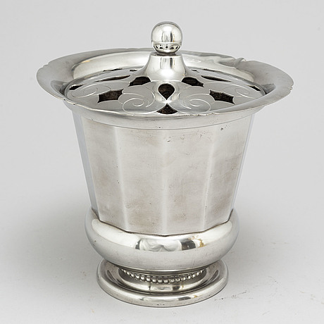 A swedish grace pewter ice bucket an pair of candlesticks, 1929 37