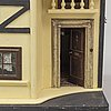 A doll's cabinet from the eraly 20th century