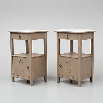 A pair of marble top bedside tables, early 20th Century.