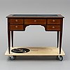 A mahogany veneered gustavian style desk, circa 1900.
