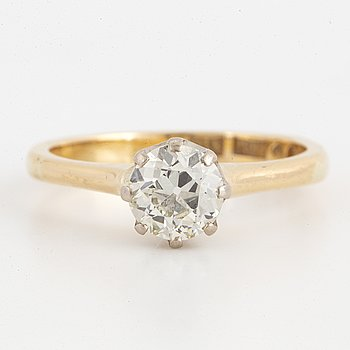 Old-cut diamond solitaire ring.