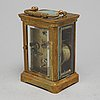 A cased travel clock, france, ca 1900.