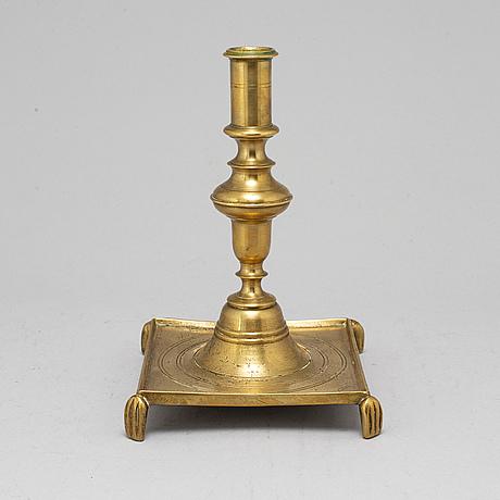 A 17th century bronze candlstick.