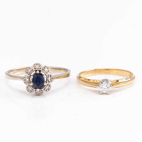 A set of two 14k gold rings with diamonds and a saphire.
