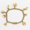 18k gold bracelet with charms.