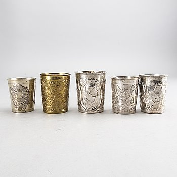 Five Russian 18th century silver and brass beakers, silver weight 292 gr, height ca 7-8,5 cm.