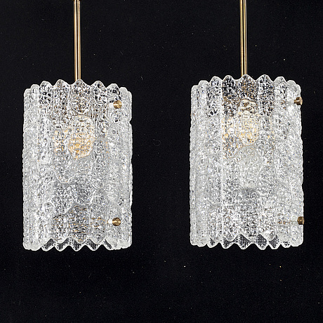 A pair of 20th century brass and glass ceiling lamps by carl fagerlund for orrefors.
