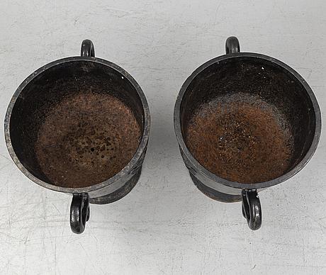A pair of cast iron garden plant pots, 20th century.