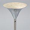 A 1930s metal floor lamp.