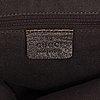 Gucci, a handbag and a cosmetic bag.