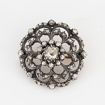 Silver and rose-cut diamond brooch.