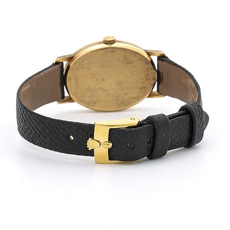 A rolex cellini ladies wrist watch 18k gold 22,5 x 29 mm.