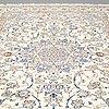 A carpet, nain part silk 307 x 206 cm.