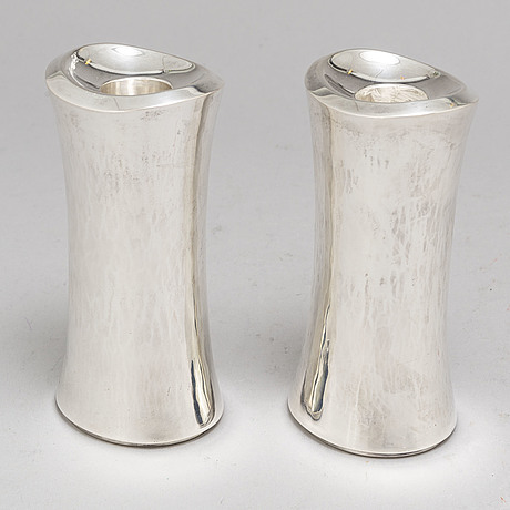 Sven carlman, a pair of silver candlesticks from cf carlman, stockholm, 1974.