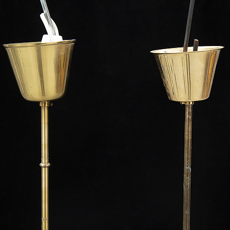 Carl fagerlund, a pair of 20th century brass and glass ceiling lamps, for orrefors.