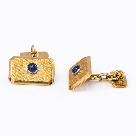 A pair of gold cufflinks with cabochon cut sapphires.