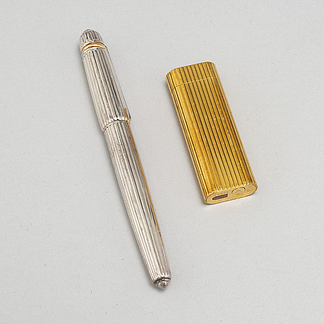 Cartier, a fountain pen and a lighter.