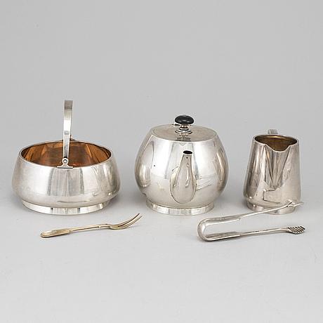 A russian early 20th century parcel-gilt silver 5 piece tea-set, mark of grachev, st. petersburg 1908-1917.