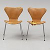 Arne jacobsen, a pair of sjuan leather chairs, 1983/1987.