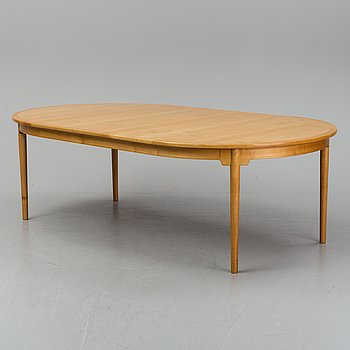 A dining table by Hans J Wegner, PP Møbler, Denmark.