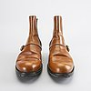 A pair of louis vuitton shoes.