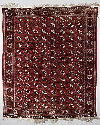 A semiantique bochara carpet ca 380 x 320 cm.