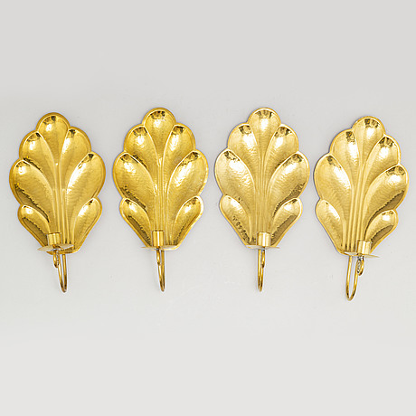 Four brass wall sconces by lars homström, arvika, second half of the 20th century.