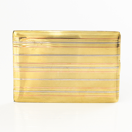 A 1980s 14k yellow, red and white gold cardholder.