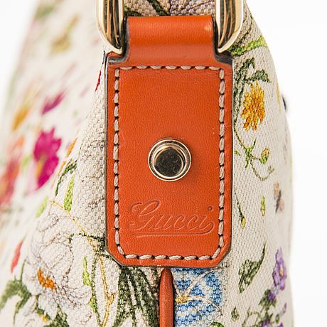 Gucci, floral canvas messenger bag.