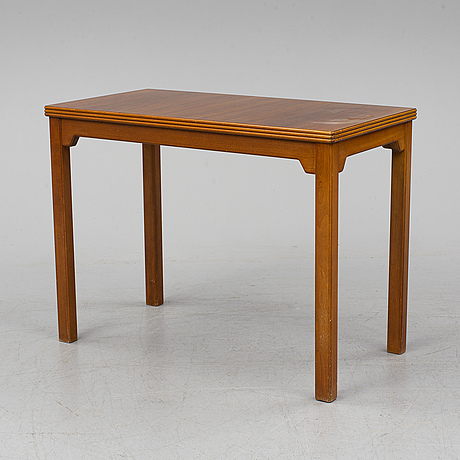 A mid 20th century table by nordiska kompaniet,.