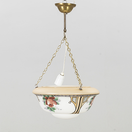 An early 1900's painted glass pendant.
