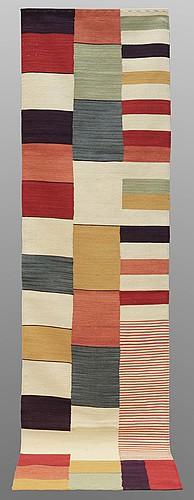 A runner, flat weave, 298 x 79 cm.