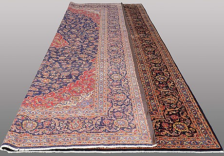A carpet, keshan, signerad, ca 537 x 304 cm.