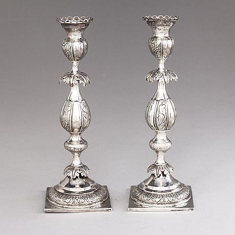 A. falk, a pair of silver candlesticks, mark of a. falk, vilnius, assay master tripeckij timofey 1865.